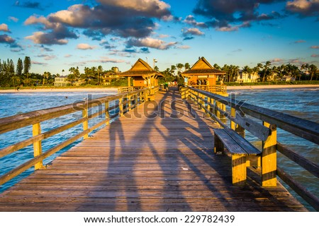 Evening light on the fishing pier in Naples, Florida. - stock photo