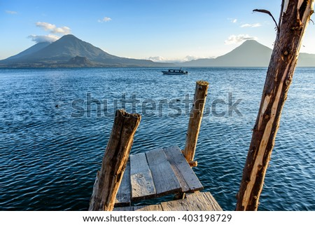 Evening light on three volcanoes, Atitlan, Toliman & San Pedro, at Lake Atitlan, Guatemala. - stock photo
