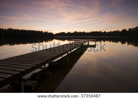 Evening light over the lake and bridge in front - stock photo