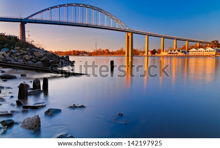 Evening long exposure of the bridge over the Chesapeake and Delaware Canal in Chesapeake City, Maryland. - stock photo