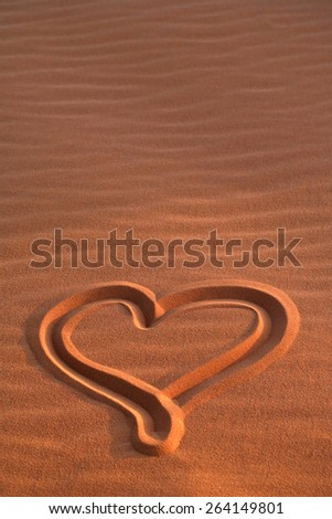 Evening love message drawn with heart in pink coral sand dunes Utah - stock photo