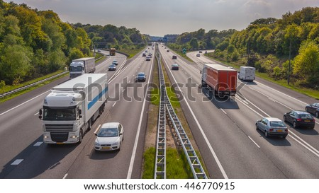 Evening motor Traffic on the A12 Motorway seen from above. One of the Bussiest highways in the Netherlands - stock photo