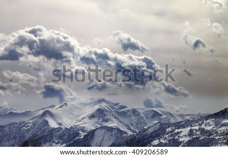 Evening mountains and cloudy sky. Caucasus Mountains. Georgia, view from ski resort Gudauri. - stock photo