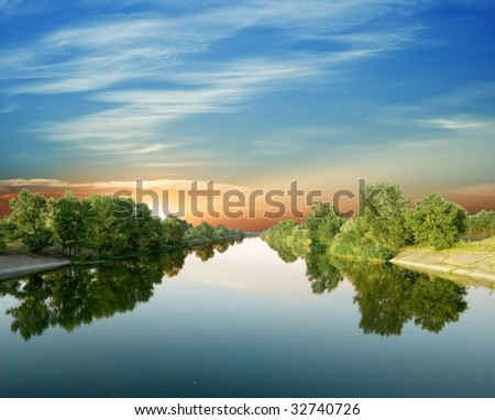 evening on a river - stock photo