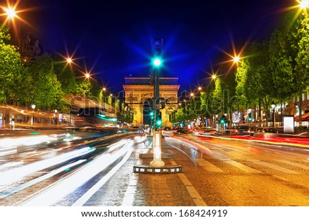 Evening on Champs-Elysees in front of Arc de Triomphe.Paris. France - stock photo