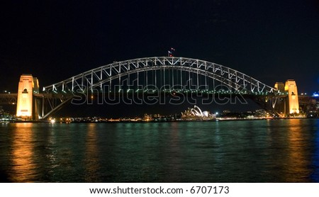 Evening on Sydney Harbor ( Harbour ) with the Bridge by Night - stock photo