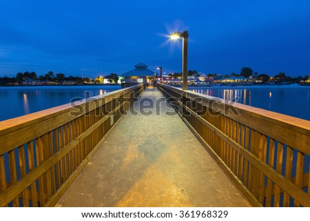 Evening on the fishing pier in Fort Myers Beach, Florida. - stock photo