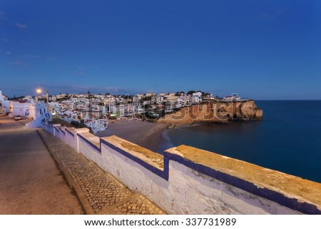 Evening over the village of Carvoeiro. View from the top the sea beaches. - stock photo