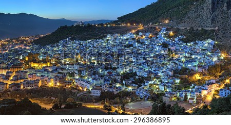 Evening panorama of Chefchaouen medina quarter with buildings painted in blue color from the hill of Jemaa Bouzafar Mosque, Morocco - stock photo