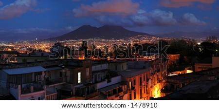 Evening panorama of city of Naples, Italy, with Vesuvius volcano in background