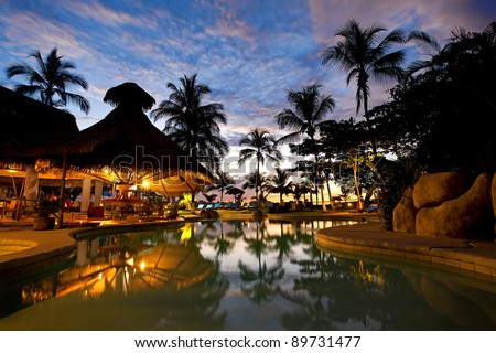 Evening picture of the swimming pool area on a resort - stock photo