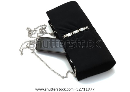 Evening purse with touchscreen cellphone, isolated - stock photo