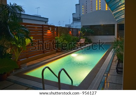 Evening rain and the pool - stock photo