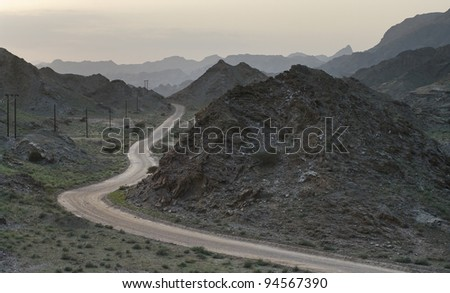 evening road winding in mountains Oman - stock photo