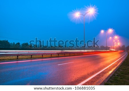 Evening road with lampposts