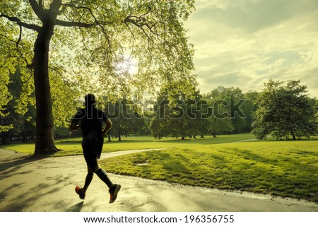 evening runner in London green Park - stock photo