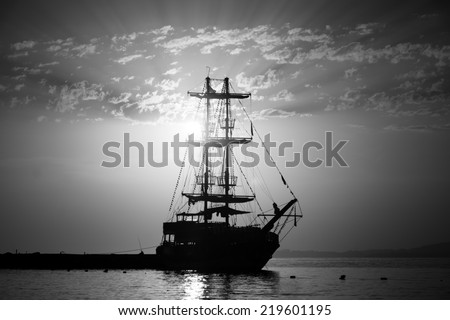 Evening. Sailboat in the bay. Black and white - stock photo