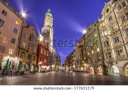 Evening scene in central Innsbruck, Austria along the famous Herzog-Friedrich scene with the Stadtturm (City Tower) and other famous historical houses. - stock photo