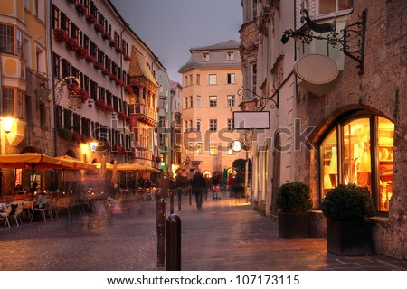 Evening scene in Innsbruck, Austria. In the background on the left, the city's landmark - the Golden Roof. - stock photo