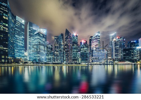Evening scene of Central Business District in Singapore, showing tall skyscrapers - stock photo