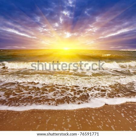 Evening scene on sea beach - stock photo