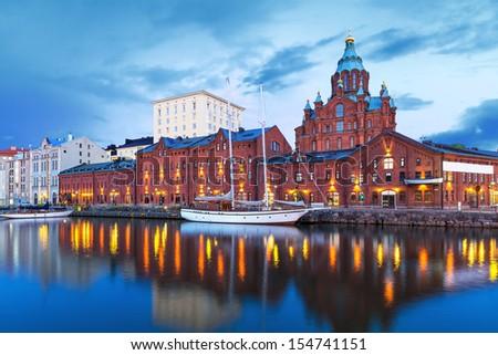 Evening scenery of Uspenski Orthodox Cathedral Church in Katajanokka district of the Old Town in Helsinki, Finland - stock photo