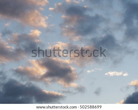 Evening sky after the rain in autumn on slight bright sky background