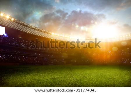 Evening stadium arena soccer field defocus background - stock photo