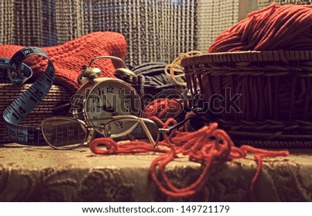 Evening still-life with a home knitting - stock photo