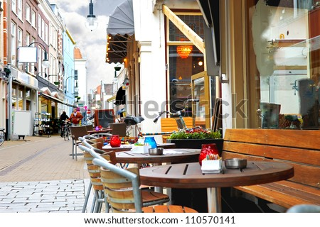 Evening street cafe in Gorinchem. Netherlands - stock photo