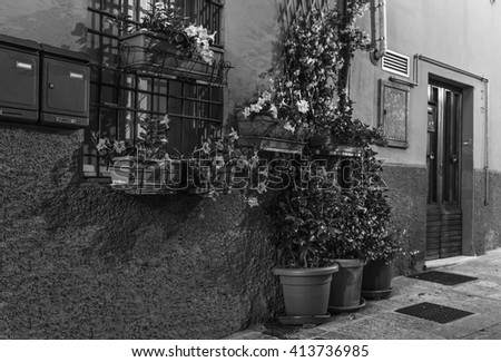 Evening street in the old town of San Marino, Italy. Black and white photography. - stock photo