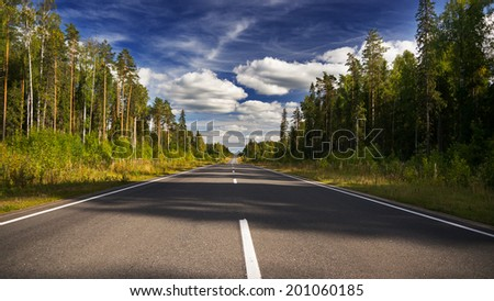 Evening summer forest road and sky - stock photo