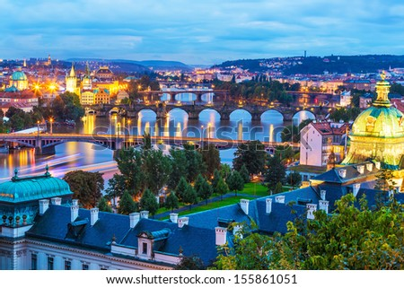 Evening summer scenery of the Old Town architecture with Vltava river and Charles Bridge in Prague, Czech Republic - stock photo
