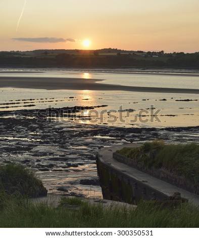 Evening Sun at low tide on Concrete Lighter barges beached at Purton to help prevent the River Severn erroding into the Gloucester Sharpness Canal - stock photo