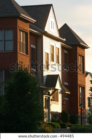 Evening sun on a townhome. - stock photo