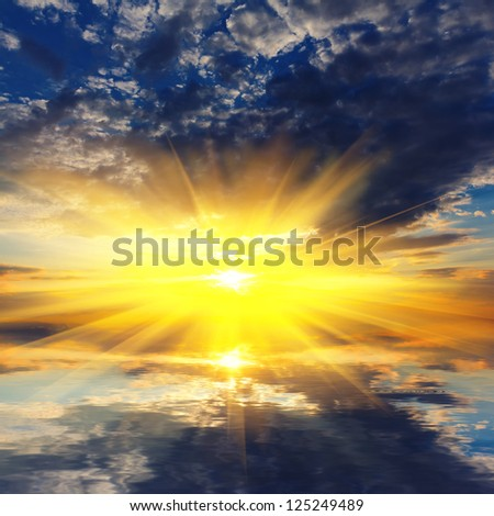 evening sun reflected in a water - stock photo