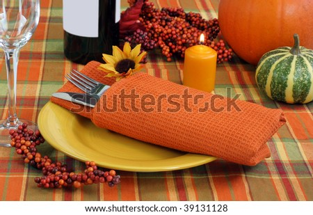 Evening table setting with autumn ambiance for the Thanksgiving holiday meal. - stock photo