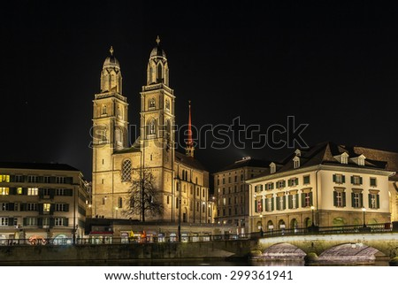 Evening. The Grossmunster is a Romanesque-style Protestant church in Zurich, Switzerland. It is one of the three major churches in the city - stock photo