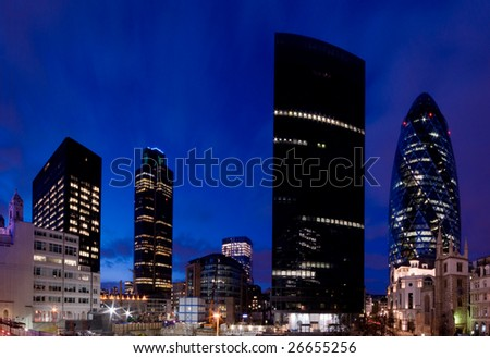 Evening time shot of London`s financial district. Including Tower 42 and Gherkin. - stock photo