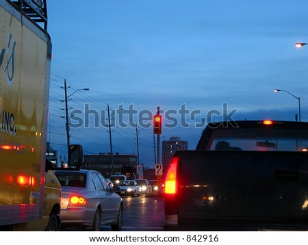 Evening traffic in the city street - stock photo