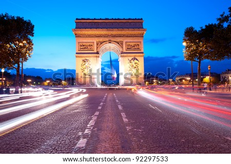 Evening traffic on Champs-Elysees in front of Arc de Triomphe Paris  France  - stock photo