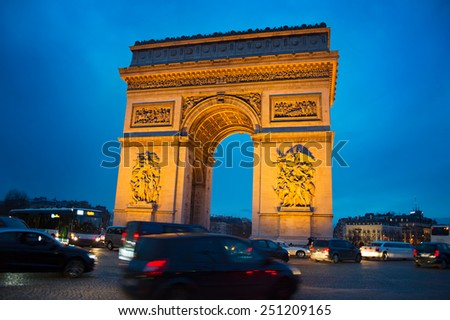 Evening traffic on Paris road near Triumph Arch. Paris - stock photo