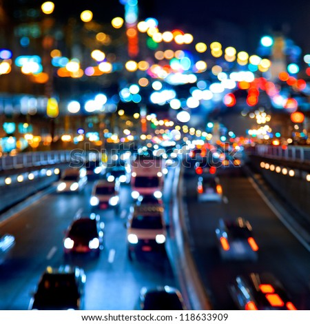 Evening traffic. The city lights. Motion blur. Abstract background. - stock photo
