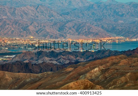 Evening view from Eilat mountains to aqaba gulf. Israel - stock photo