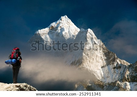 Evening view of Ama Dablam with tourist - way to mount Everest base camp - Sagarmatha national park - Nepal - stock photo