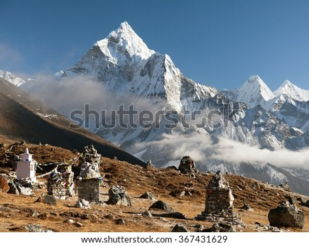 Evening view of buddhist prayer flags and chortens under mount Ama Dablam, beautiful view from Khumbu valley, Solukhumbu, way to Everest base camp - Sagarmatha national park - Nepal - stock photo