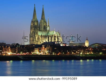 Evening view of Cologne Cathedral from the Rhine river, Germany - stock photo