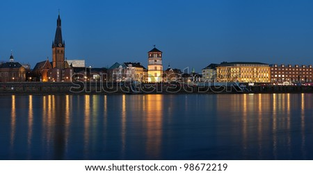 Evening view of Dusseldorf Old Town with Basilica of St. Lambertus, Schlossturm and building of old City Hall, Germany - stock photo