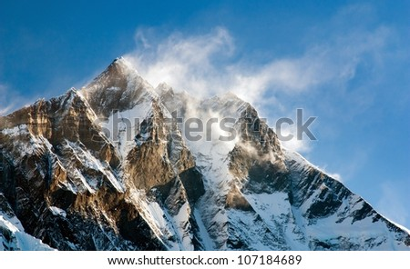 evening view of Lhotse with windstrom and snow clouds on the top