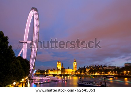 Evening view of London Eye and House of Parliament. UK - stock photo